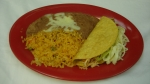Taco - Served with rice and beans